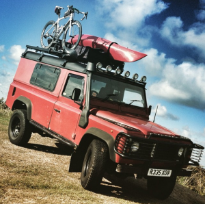 LandRover Defender with Bicycle & Kayak on Front Runner roof rack